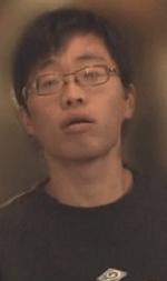 青がっぱの男の顔写真の画像